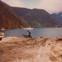 """Brian, Partner and Chimo, with the """"Marabella"""" in the background."""